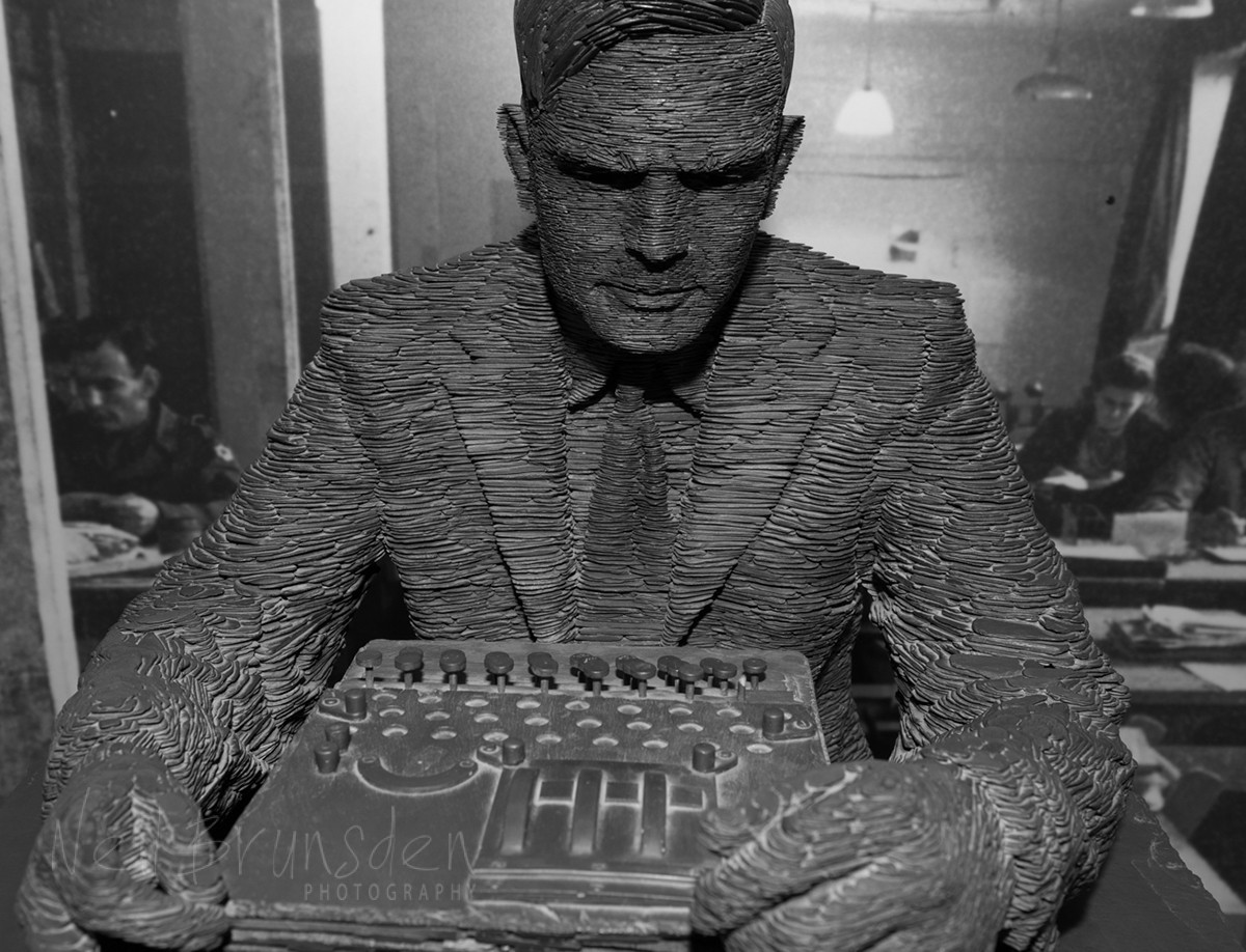 Alan Turing contemplating an Enigma Machine
